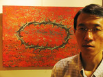 "Asian Christian artist Tan Chee Hon and his work ""Crown""."