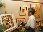 A participant at the Faith & Order meeting admires the art exhibition.