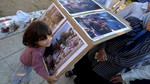 The youngest in the Al-Kurd family, 3-year-old Maha, brings the photo displays documenting the eviction of August 2009 and conflicts since then, to show the WCC delegation that visited on 29 August 20