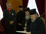 On Thursday, 2 September 2010, the Cross of the Order of the Holy Sepulchre was presented to the WCC general secretary Rev. Dr Olav Fykse Tveit by Patriarch Theophilos III of Jerusalem.