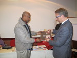 Rev. Dr Olav Fykse Tveit hands over a copy of Keeping the Faith to CLAI president Bishop Julio Murrayatives of PAD and ACT Alliance Brazil Forum.dent Bishop Julio Murray