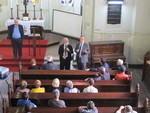 Rev. Dr Olav Fykse Tveit and Rev. Dr Walter Altmann address participants of the weekly prayer service for homeless people at Lutheran congregation in São Paulo