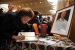 Signing a Mandela memorial book